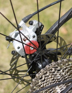 The rear end is spaced for 130mm hubs and our bike came with Velocity's 130mm-spaced Major Tom alloy disc wheels