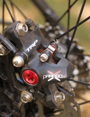 The rear caliper is smaller than the front to save weight, we found it to provide plenty of power, even with a 140mm rotor