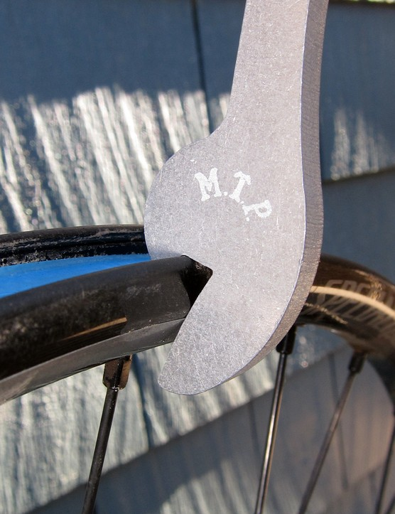 The Rim 'Rench's aluminum construction is a little easier on soft alloy rims than typical tool steel. To pull out a dent, simply hook the damaged area and pry it out as shown here