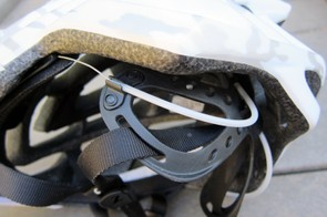 The Rollsys dial up top is connected to steel cables running around the sides and front of the rider's head