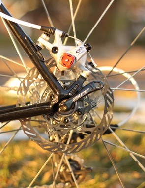 The lower alloy part of the brake mount/dropout appears to plug into the chain and seatstays