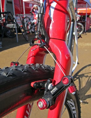 The front brake housing stop is mounted to the crown to prevent fork shudder