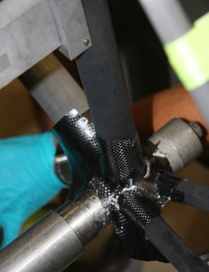 The outer skin carbon fiber of a bottom bracket being wrapped onto a custom Parlee Z1 road bike