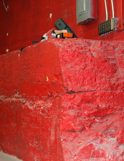 The lower floors' rounded red wall is an artifact of the building's former purpose: home to a railway turntable. Two separate tracks still run just east of the building