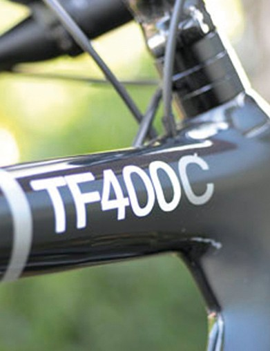 Smooth all-carbon lines of the new T400c include a 'between tube' airflow smoothing web and neat internal cabling