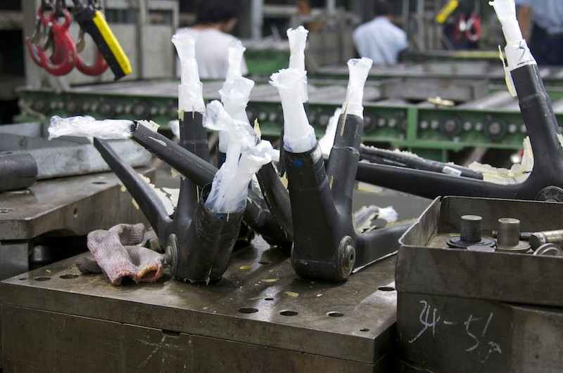 Specialized are responsible for creating many carbon frames (pictured, in-process) and components, and now they're looking for a responsible way to recycle them