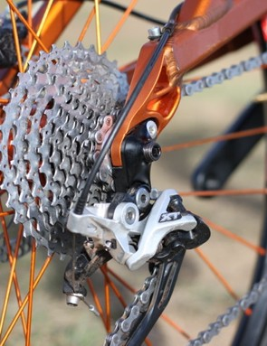Turner's 142x12 through-axle uses a combo, replaceable rear derailleur hanger/axle nut