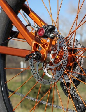 The rear brake boss is for direct mount 160mm rotors; notice the replaceable threaded cylinders, so as a rider never needs to worry about stripping the frame