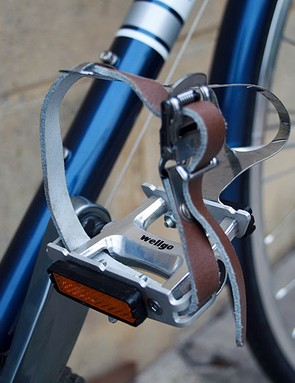 Leather pedal straps maintain the retro look