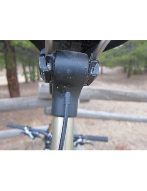 A very clean cable stop guides a standard shifter cable inside the post head to the pinch bolt and actuation lever