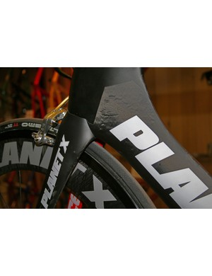 The fork crown flows into the deep head tube on the Planet X Exocet 2