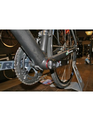 A rubber bung helps shield the cables as they exit the down tube on the Planet X Team Guru Special Edition