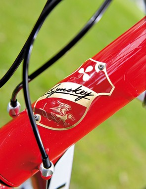 The badged head-tube hides an oversized internal headset