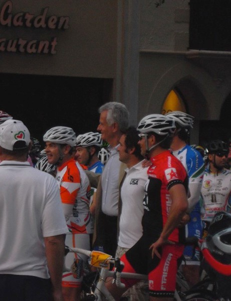 Tour de France winner Jan Ullrich poses with organizers before the start of the ride
