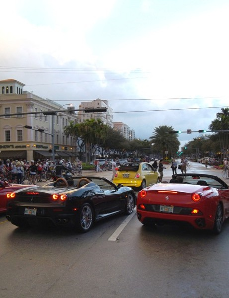 Ferraris and a Fiat prepare to pace the riders at the start of the Miami Gran Fondo