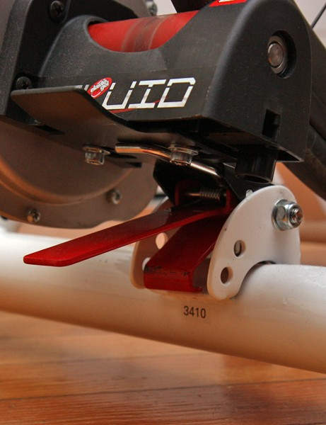 The resistance unit is spring loaded for no-guess tensioning and locks down for easy bike loading/unloading