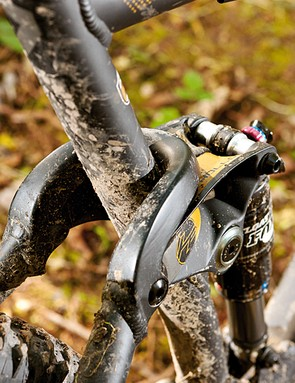 The rear triangle wraps around the seat tube to substantially stiffen things up