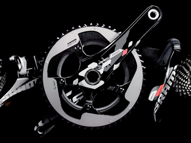 "The new crank gets a hidden fifth arm, a generally more stoutly reinforced chainring spider, and an outer chainring that closely resembles the current TT-specific model. Also, note the ""X-Glide"" marking, which suggests an updated ramping profile"