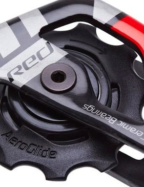 The revamped SRAM Red rear derailleur pulley teeth get a soft polymer coating for reduced noise. Hybrid ceramic bearings will come standard, too, along with what looks to be aluminum bolts