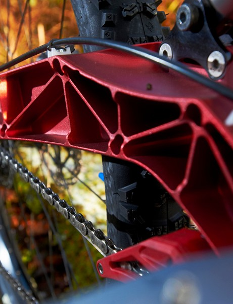 The swingarm is intricately CNC machined