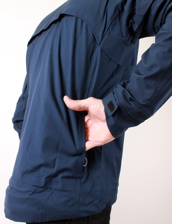The rear of the jacket has a pocket and flap style vent