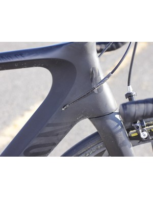 The internal cable routing is as sleek at the front of the bike