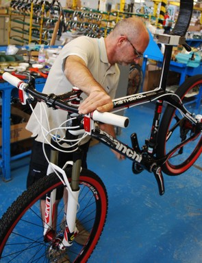 Mountain bikes, city bikes and road bikes are assembled side by side, but each bike is built up individually rather than on an assembly line