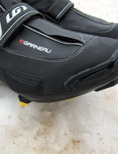 Various sections of the shoe are reinforced against wear