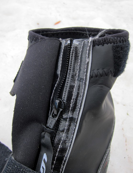 The waterproof zipper would probably fare fine on its own against wind and road spray but additional inner and outer flaps are on hand regardless