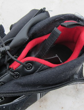 Multiple loops on both the inner shoe and outer cover make it easier to get the Glacier RD on. The speed lacing system is quick to use but tough to adjust mid-ride