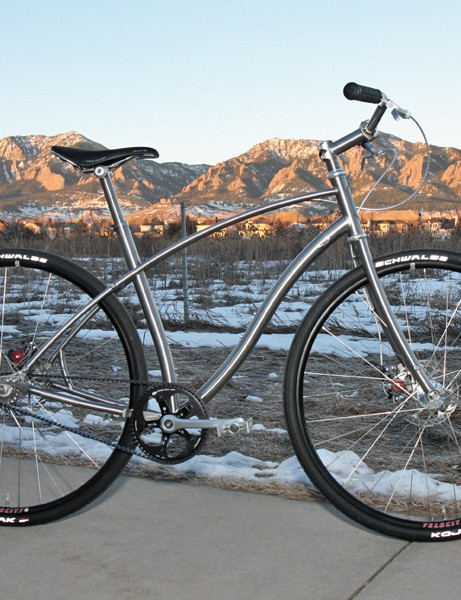 Budnitz builds his bikes with swoopy, cantilevered titanium tubing and twin, small-diameter top tubes for a smooth ride