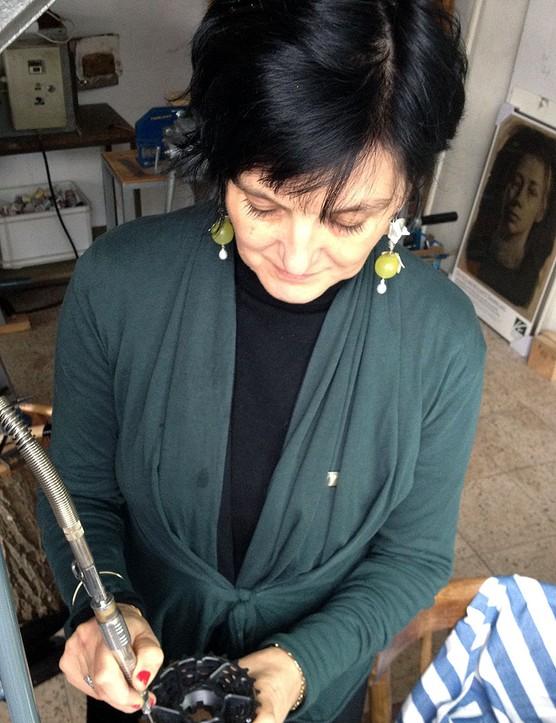 Jeweller Marieke Russel attaches cubic zirconias to the cassette