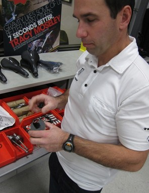 The Race Shop's road and triathlon engineer, Mark Andrews, digging through the Madone drawer