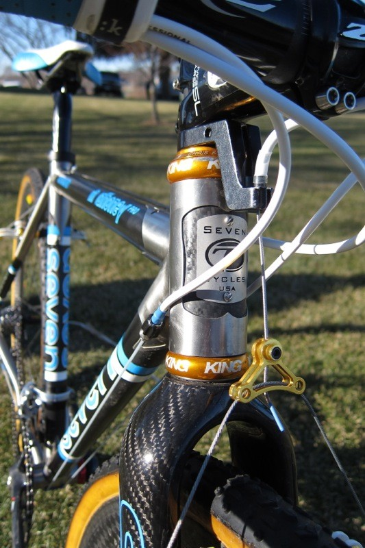 The Mudhoney Pro uses a carbon head tube that's wrapped in titanium. Mo's is just 90mm tall