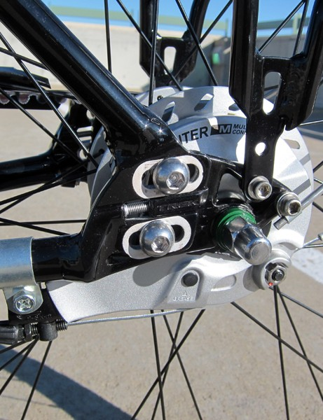 The sliding dropouts are easier to use and less prone to creaking than a bottom bracket eccentric. Pity Trek didn't integrate the anchor for the drum brake torque arm into the frame itself, though