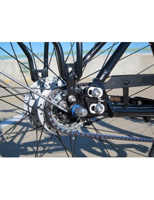 The driveside dropout can be separated from the seatstay (the bolt is hidden behind the plate) so that the belt can be fed into the rear triangle
