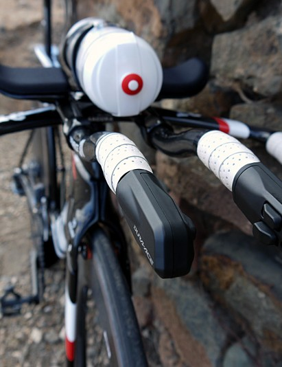 Mounting the bottle on the bars reduces drag by closing in that gap, say Cervelo