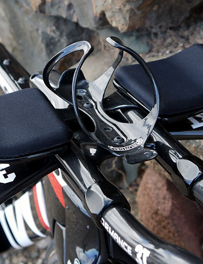 A close up of the water bottle cage on the bars