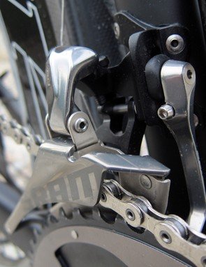 The parallelogram pivots in the new front derailleur aren't actually parallel. By angling them relative to each other, SRAM engineers were able to tune in a bit of rotational movement as the cage moves through its range to help eliminate chain rub