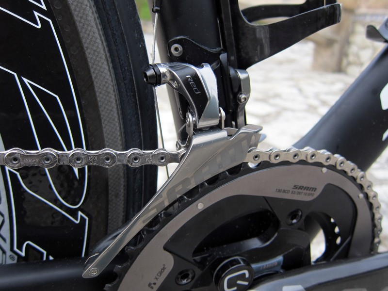 The new front derailleur is a major improvement over the old titanium-caged version. The new steel and aluminum cage is much stiffer than before and more effective at moving the chain back and forth under high pedal loads