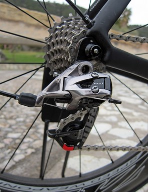 The revamped rear derailleur feels just as snappy as before but the lines are cleaner, there's better tool access on the main mounting bolt, and the longer knuckle up top can now handle a 28-tooth cog. Even the barrel adjuster is an improvement over the old version