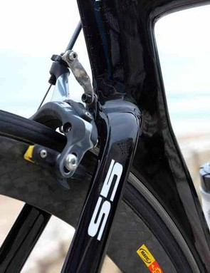 The rear brake is first bolted to a small aluminum mount, which is then inserted into the frame
