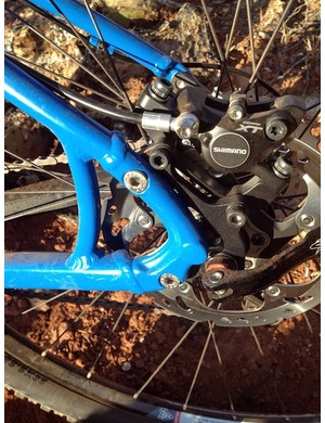 Santa Cruz's clever new dropouts pivot about the upper bolt to tension the chain on singlespeed setups. Integrated IS brake mounts and vertical dropouts maintain brake caliper adjustments during wheel changes, too