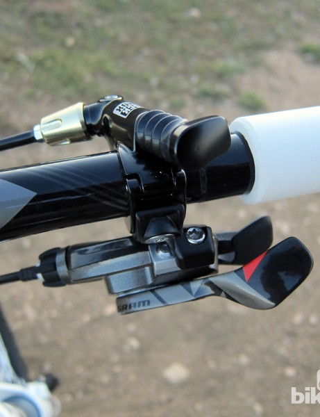 The hydraulic remote lockout lever on the RockShox SID XX 29 fork is neatly integrated into the rest of the control with no additional clamps required