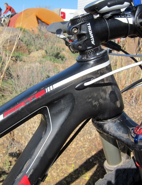 The internally routed derailleur cables are fed into the frame just behind the tapered head tube