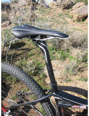 A women's-specific Specialized Ruby Expert saddle is mounted atop a two-bolt Specialized S-Works carbon seatpost