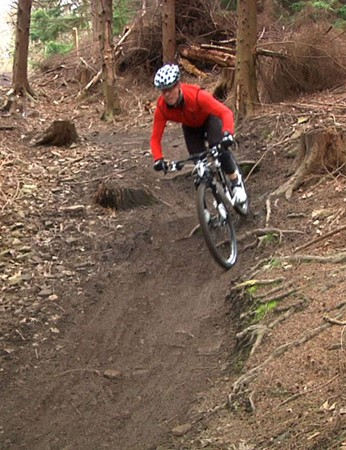 Justin pilots his 29er on a slippery downhill section
