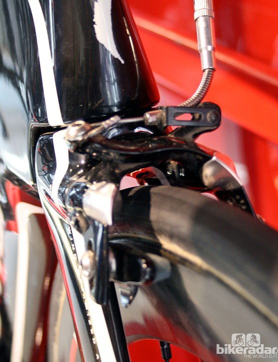 The 2012 Specialized S-Works Shiv loses the controversial nose cone from the previous version, outlawed by the UCI on the grounds of it solely serving as an aerodynamic aid, and not functional to the frame's structure. The new model had exposed brake callipers