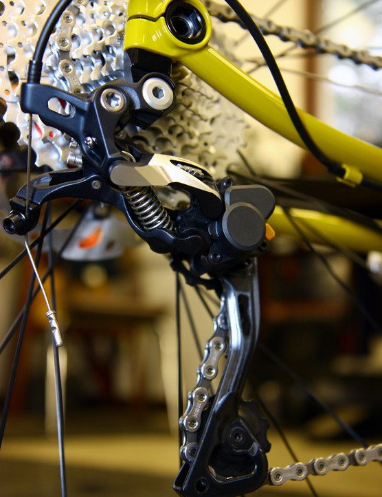 The stout derailleur hanger is bolted to the bottom of the thru-axle dropout on this Retrotec