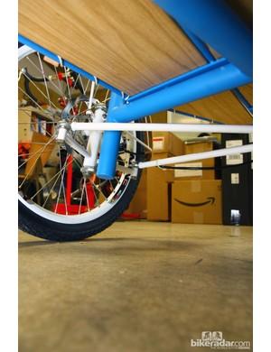 Getting both front wheels to turn at the right angle on this Sycip cargo trike requires a lot of hardware